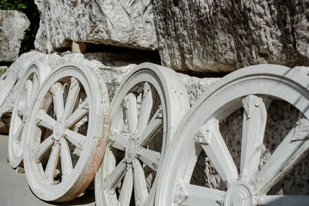 The Samsara stone wheel carved from marmore. Stock Photo
