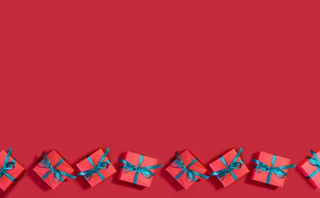 Image of beautiful red gift boxes on a red background. Stok Fotoğraf