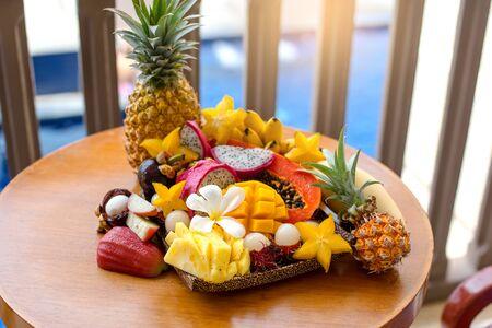 Juicy ripe tropical Thai fruits on a wooden dish. Archivio Fotografico - 136302396