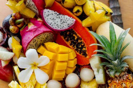 Juicy ripe tropical Thai fruits on a wooden dish. Archivio Fotografico - 136302661