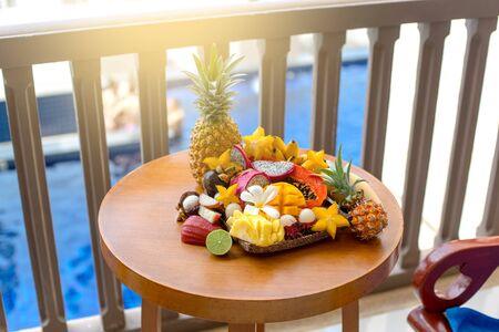 Juicy ripe tropical Thai fruits on a wooden dish. Archivio Fotografico - 136302679