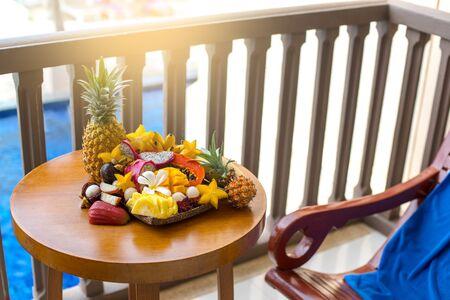 Juicy ripe tropical Thai fruits on a wooden dish. Archivio Fotografico - 136227482
