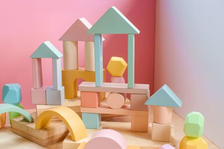 A town made of elements of a wooden childrens designer of pastel colors. 版權商用圖片
