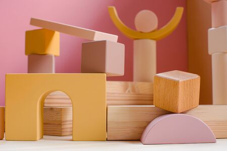 A town made of elements of a wooden childrens designer of pastel colors.