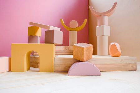 A town made of elements of a wooden childrens designer of pastel colors. Фото со стока