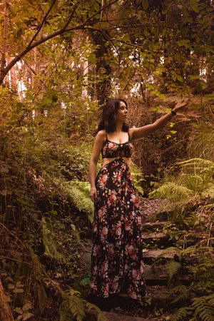 young woman in the forest observing nature