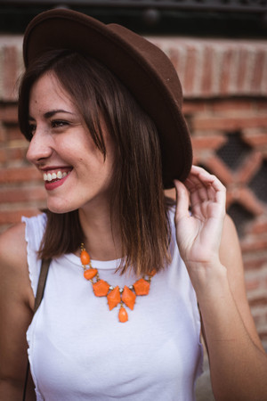 Portrait of Fashionable woman with accessories holding hat with a smile Reklamní fotografie