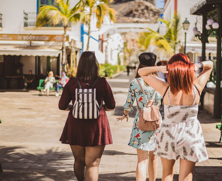 Three young women are walking around the city in Mogan, Canary islands, diversity Reklamní fotografie
