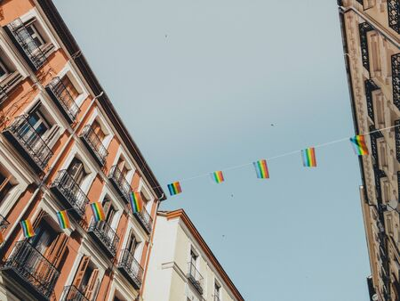 rainbow LGBT flag waves against blue sky in Madrid city Reklamní fotografie