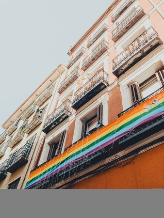 rainbow LGBT flag against blue sky in Madrid city Reklamní fotografie