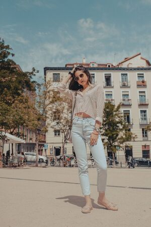 Beautiful young tourist woman visiting the city of Madrid, Spain. Model posing on the street.