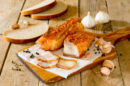 salo: Salo, cured pork fat, bacon on a wooden board. Traditional Ukranian dish Stock Photo