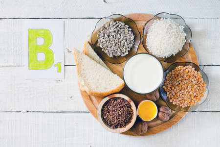 b: Foods containing vitamin B 1: rice, sunflower seeds, milk, peas, buckwheat, egg yolk, bread, walnuts Stock Photo