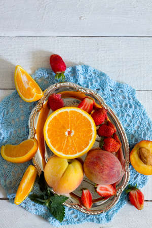 luscious: Assortment of luscious fruits and berries on a wooden background