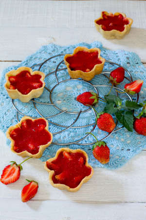 shortbread: cake with strawberry tarts, shortbread dough and strawberry jelly Stock Photo