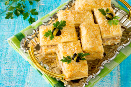napoleon fish: Napoleon cake appetizer on a wooden table