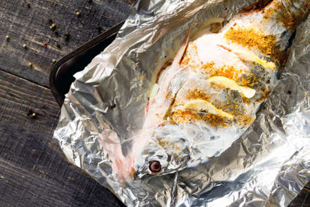 raw fish: Raw fish (carp mirror) in sour cream, preparations for baking.