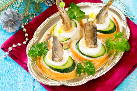sprats: Canapé with fresh cucumber, egg and sprats Stock Photo