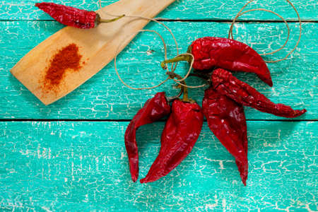 chili powder: Chili peppers and dry on a wooden blade