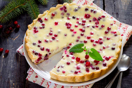 homemade cake: Cakes, pies, shortbread dough with fresh cranberries flooded New Years Eve. Stock Photo
