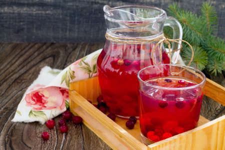 cranberry fruit: Red cranberry fruit drink, a pitcher and a glass.