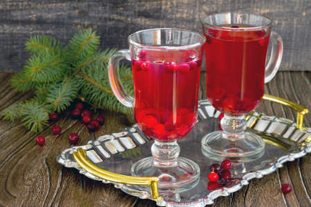 cranberry fruit: Red cranberry fruit drink two glasses on a tray.