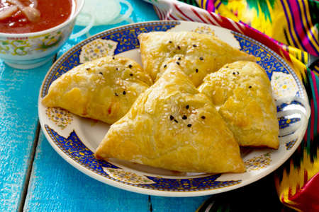 samosa: Traditional oriental food samosa, meat pies on a wooden table Stock Photo