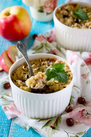 Dessert crumble with apple and nuts in a rustic style Stock Photo