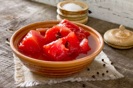 watermelon marinated in a ceramic bowl in a rustic style