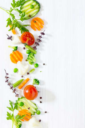 Fresh delicious ingredients for cooking on a wooden background. Diet or vegetarian food concept.