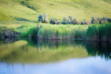 volga: Reflection in water Sunset scene on the river. The Volga region, Volga river. Russia. Stock Photo