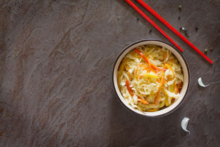 korean salad: Korean salad of cabbage, carrots, sweet peppers - kimchi. Top view, copy space.
