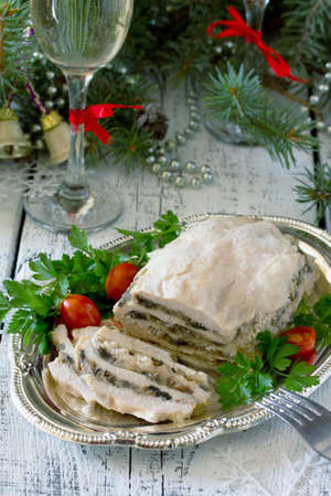 gelatina: Homemade meat chicken roll with mushrooms, onions and gelatin on the Christmas table. Foto de archivo