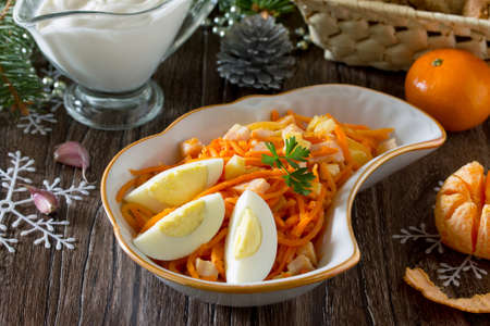 korean salad: Festive salad for the Christmas table: carrots in Korean with cheese, egg and meat. Stock Photo