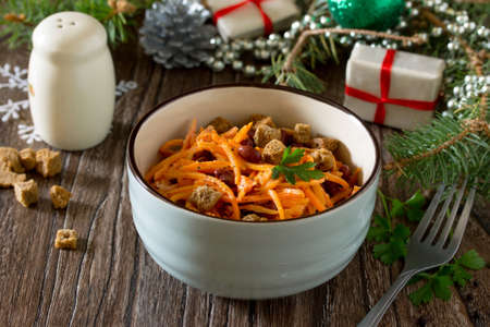 korean salad: Festive salad for the Christmas table: carrots in Korean with red beans, garlic and crackers.