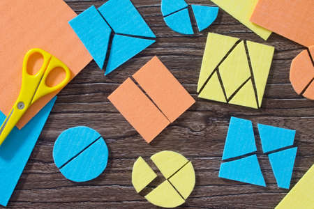 Puzzle study of mathematical fractions and square Gather on the wooden table. The concept of early childhood development.