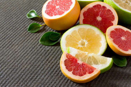 Citrus grapefruit set on a concrete gray background. The concept of healthy nutrition and diet.