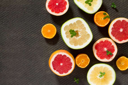 Citrus set of grapefruit and fresh mint on a concrete gray background. Top view. Healthy food concept.