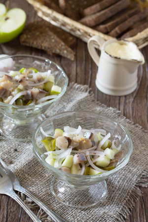 Festive salad with pickles, onions, mustard and apple. Appetizer on the table Christmas or New Year.