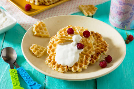 Dinner or lunch for children - cakes and fruit, waffles with cottage cheese and sour cream. Food for children.