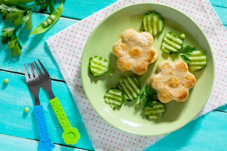 Dinner or lunch for children - roasted meat or fish souffle, steam cutlets. Food for children. Top view. Stock Photo