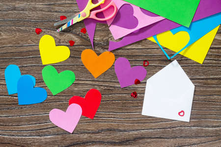 love declaration: Greeting frame birthday or Valentines Day. Heart from paper rainbow envelope. Declaration of love.