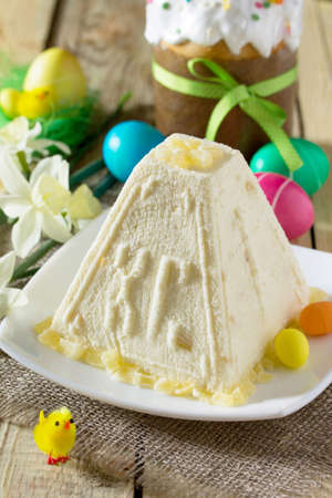 Easter background. Traditional Easter holiday table: cake, Easter and colorful Easter eggs. Stock Photo
