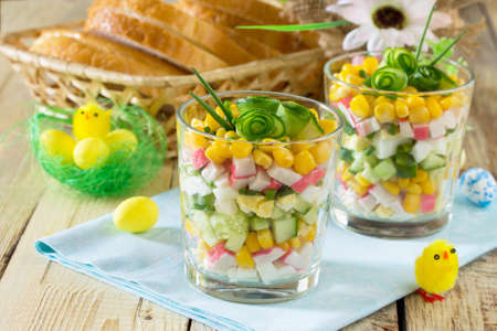 Salad with crab sticks, eggs, corn and fresh cucumber - the idea of Easter dinner, holiday recipe.