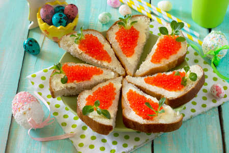 Easter carrot bread with butter and red caviar, the idea of Easter culinary craft for children.