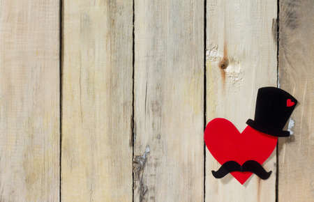 A cheerful fathers day background or card with copy space. Black hat, mustache and red heart.