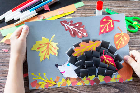 Autumnal application of a hedgehog and deciduous leaves. Childrens Art Project, needlework, crafts for kids.