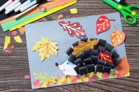 Autumnal application of a hedgehog and deciduous leaves. Children's Art Project, needlework, crafts for kids. Top view with a copy. Archivio Fotografico