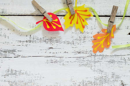 Autumn frame. Garland of multicolored leaves of trees. Childrens art project, craft for children. Craft for kids.