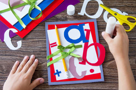 Greeting card with a pencil and letters for the new school year. Welcome back to school. Childrens Art Project, needlework, crafts for kids. Lizenzfreie Bilder
